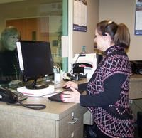 Clerk at a computer assisting a citizen
