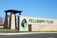 A stone and brick sign with the Pellissippi Place logo
