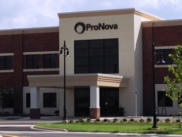 "A large brick building with a sign reading, ""ProNova."""