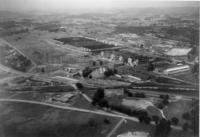 A black and white aerial photo of a facility.