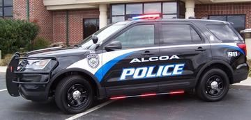 Side view of Alcoa Police Cruiser with red lights