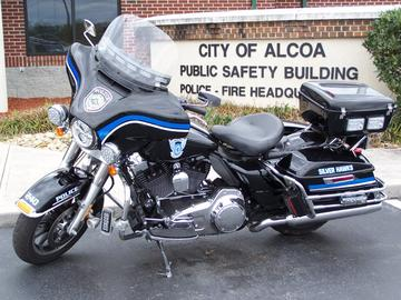 Side view of an Alcoa Police Department Motorcycle in front of the Public Safety Building